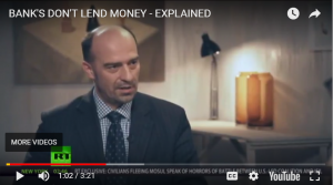 Banks don't lend money - explained - video still of man talking in talk show setting